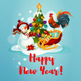 Snowman, rooster and pine tree Stock Photo