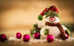 Snowman on a rustic wooden board Royalty Free Stock Image