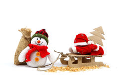 Snowman with sackcloth bag and sledge, Christmas tree, Santa Cla Royalty Free Stock Photography