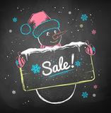 Snowman with sale signboard. Royalty Free Stock Photography