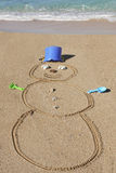 Snowman in the Sand - Fun on the beach in winter - Maui, Hawaii Royalty Free Stock Photography