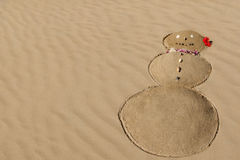 Snowman in the Sand - Fun on the beach in winter - Maui, Hawaii Royalty Free Stock Images