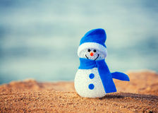 Snowman on sand Royalty Free Stock Photo