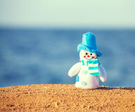 Snowman on sand Royalty Free Stock Image