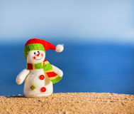 Snowman on sand Royalty Free Stock Photos