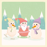 Snowman and Santa Claus among the mountains Royalty Free Stock Photos