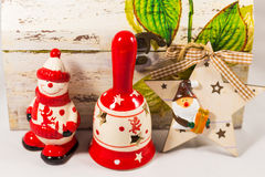 Snowman, Santa claus star, bell and wooden box, concept of Merry christmas and Happy New Year Stock Photography