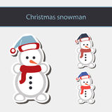 Snowman in Santa Claus xmas hat. Royalty Free Stock Image