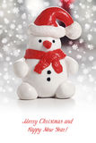 Snowman with Santa Hat. Christmas greeting card Royalty Free Stock Photo