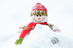 Snowman  with santa hat and christmas ornaments Stock Photos