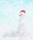 Snowman with Santa hat in winter snow fall, Stock Images