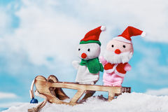 Snowman and Santa toy Stock Images