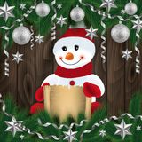 Snowman with scroll and festive decoration. Illustration of snowman with scroll, fir tree branches, Christmas balls, stars, streamers and wood background Royalty Free Stock Photography