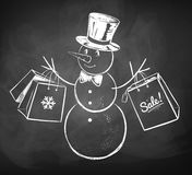 Snowman with shopping bags Royalty Free Stock Images