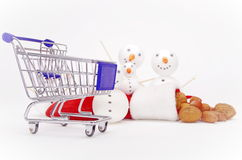 Snowman shopping cart Royalty Free Stock Image
