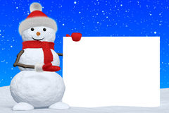 Snowman shows blank white board under snowfall Royalty Free Stock Image
