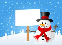 Snowman with sign in his hand Royalty Free Stock Image