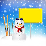 Snowman with sign in snow Stock Photo