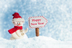 Snowman with Signpost, Happy New Year Stock Photography