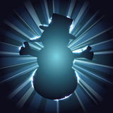 Snowman silhouette against a starburst. Dark blue snowman silhouette with sparkles and a starburst background. Graphics are grouped and in several layers for Stock Image
