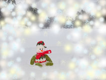 Snowman sits on the snow. Royalty Free Stock Image