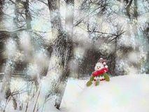 Snowman  sits on the snow hill. Snowman has green, red ang white clothes. Background consists with de focused blue and yellow flake of snow. Snowflake Royalty Free Stock Photography