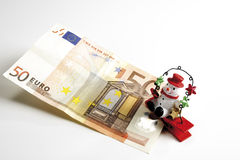 Snowman sitting on Euro notes, elevated view Royalty Free Stock Images
