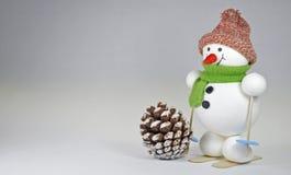 Snowman on the ski Stock Photos
