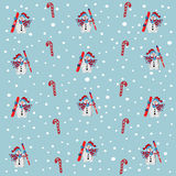 Snowman with skies and snowboard. snow fall pattern Royalty Free Stock Photography