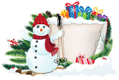 Snowman on skis and Christmas gifts Stock Photo