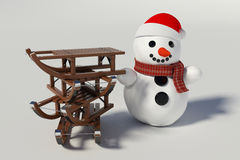 Snowman, skis and four wooden sleds with him Stock Photo