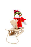 Snowman on a sled with Christmas tree. Stock Images