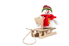 Snowman on a sled with Christmas tree. Stock Photos