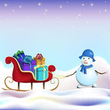 Snowman with sled and gifts Stock Photos