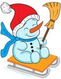 Snowman on a sled Stock Photos
