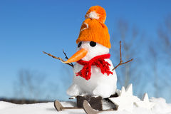 A snowman and a sled Royalty Free Stock Photography