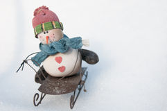 Snowman on a sled Stock Photo