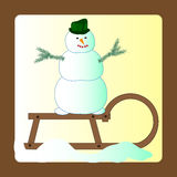 Snowman on a sled Royalty Free Stock Image