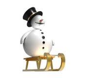 Snowman on sledge Stock Photos