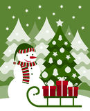 Snowman and sledge. Snowman and gifts on sledge Stock Photo