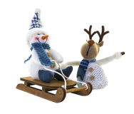 Snowman on a sledge with reindeer Stock Images