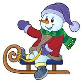 Snowman on sledge theme image 1 Royalty Free Stock Image
