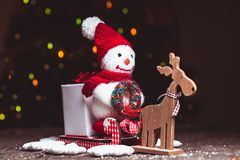 Snowman on sledges Royalty Free Stock Photography
