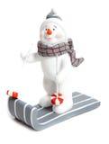 Snowman on a sleigh royalty free stock photos