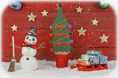 Snowman with sleigh and Christmas tree Stock Image