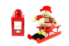 Snowman on sleigh with red lantern Royalty Free Stock Photography