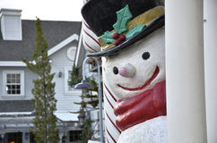 Snowman in small town Royalty Free Stock Photos