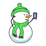 Snowman with a smartphone. Congratulations online. Christmas. Royalty Free Stock Photo