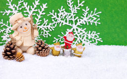 Snowman in snow. Cute snowman figure in snow with three santa claus figures - christmas decoration Royalty Free Stock Photography