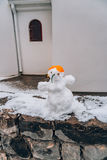 Snowman from the snow on the street Stock Images